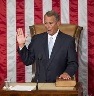 House Speaker John Boehner of Ohio takes the oath of office after being re-elected to a third term.