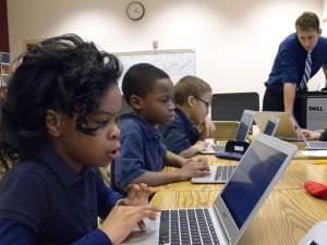 Young students working at computers in a school computer lab