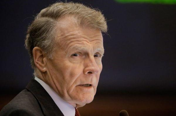 House Speaker Michael Madigan talks to lawmakers in Springfield December 3.