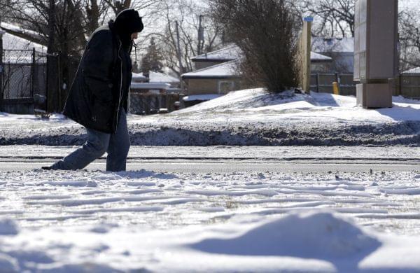 a person walking through the snow
