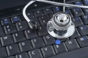 a stethoscope sitting on a computer keyboard