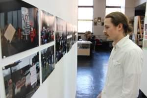 Travis Hocutt curator for the Black Lives Matter gallery at the Independent Media Center looks at the images in the exhibit