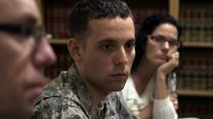 Adam Winfield is seen with his parents during a meeting with the family's defense attorney at Ft Lewis.