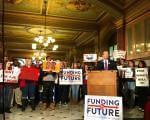 State Sen. Andy Manar (D-Bunker Hill) speaks to supporters of his school funding bill at a rally in the Capitol rotunda in December.