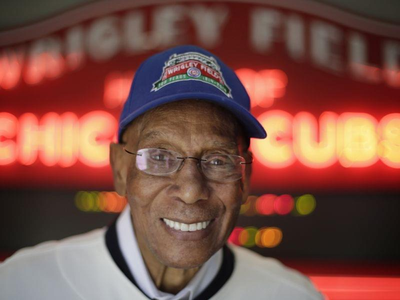 In a March 2014 file photo, Ernie Banks smiles after an interview at the Cubs offices in Chicago.