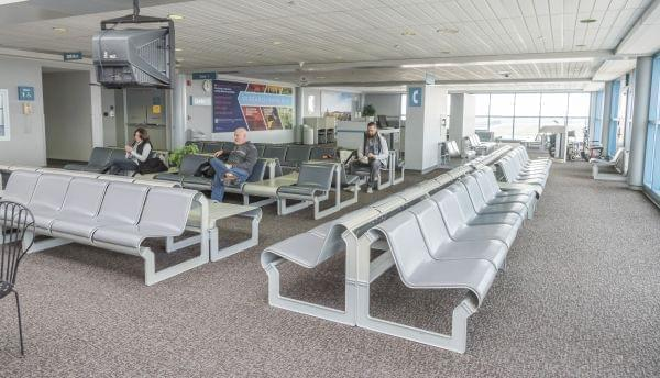 Passengers wait in the terminal for flights out of WIllard Airport.Passengers wait in the terminal for flights out of WIllard Airport.