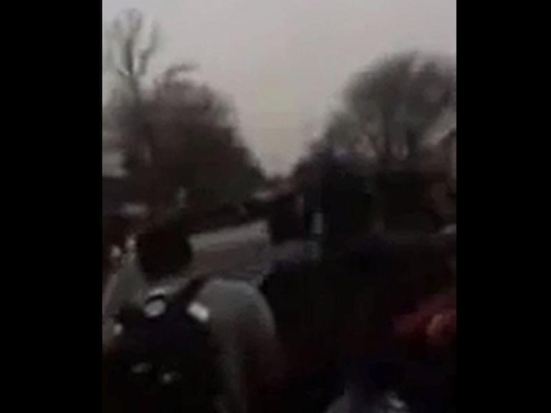 Screenshot of video showing a car driving through a student rally outside Centennial High School.