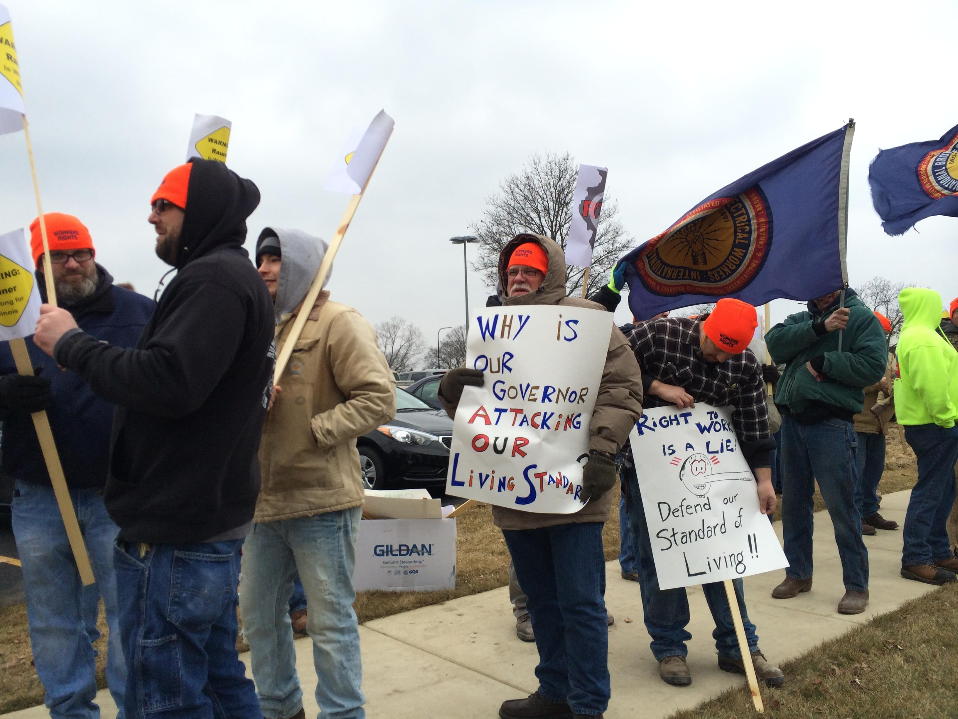 Local union members turn out for a rally outside Gov. Rauner's speech in Champaign on Thursday.