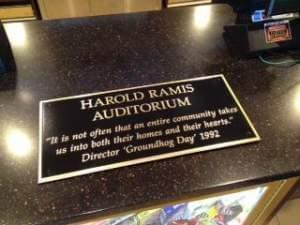 "A plaque that reads ""Woodstock Theater Dedicates Auditorium To Harold Ramis"""