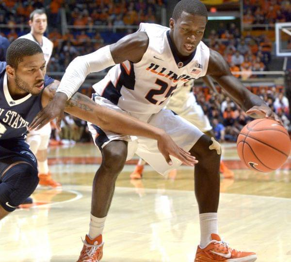 Illinois' Kendrick Nunn controls the ball in front of Penn State Guard D. J. Newbill.