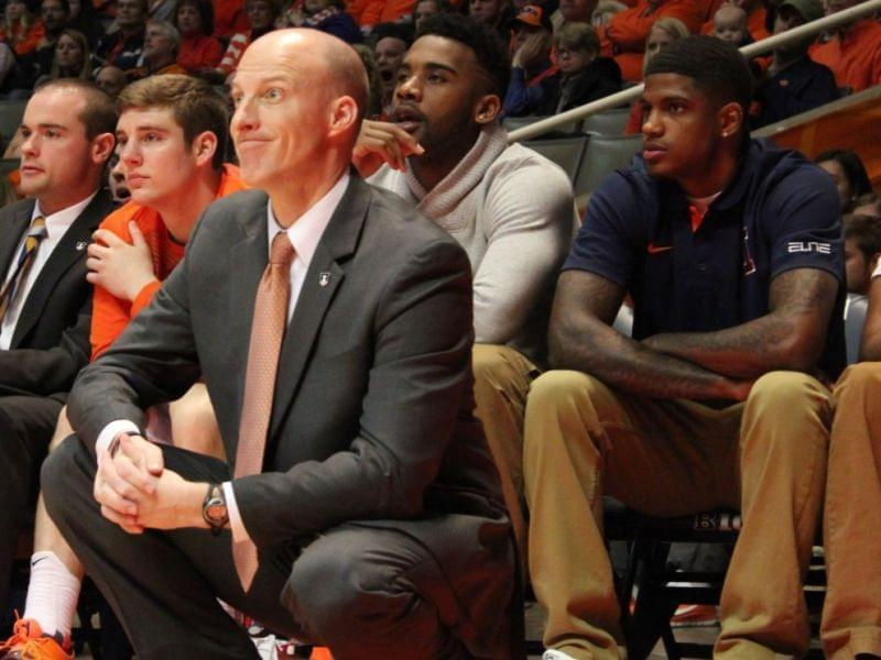 John Groce sits on the sidelines with Aaron Cosby and Rayvonte Rice.