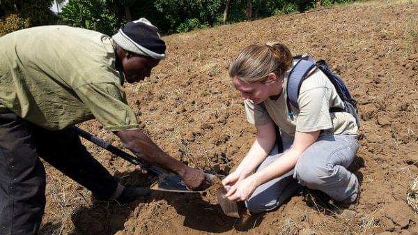 Shea Belahi teaches farmers in Tanzania about soil health.