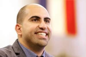 Steve Salaita, a professor who lost a job offer from the University of Illinois over dozens of profane Twitter messages that critics deemed anti-Semitic, speaks to students and reporters during a news conference at the University of Illinois campus T