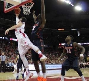 isconsin's Frank Kaminsky goes around illinois' Nnanna Egwu for a lay-up.
