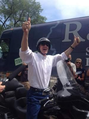 Bruce Rauner rolls into Republican Day at the 2014 Illinois State Fair on his Harley. Rauner says he loves the outdoors: ridin' his motorcycle, huntin' and fishin'...but others wonder if the governor is fakin' his 'common man