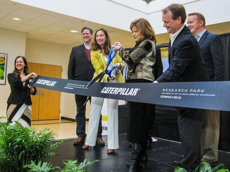 Caterpillar, University of Illinois and Champaign officials cut a ceremonial ribbon to open the Caterpillar Data Innovation Lab.