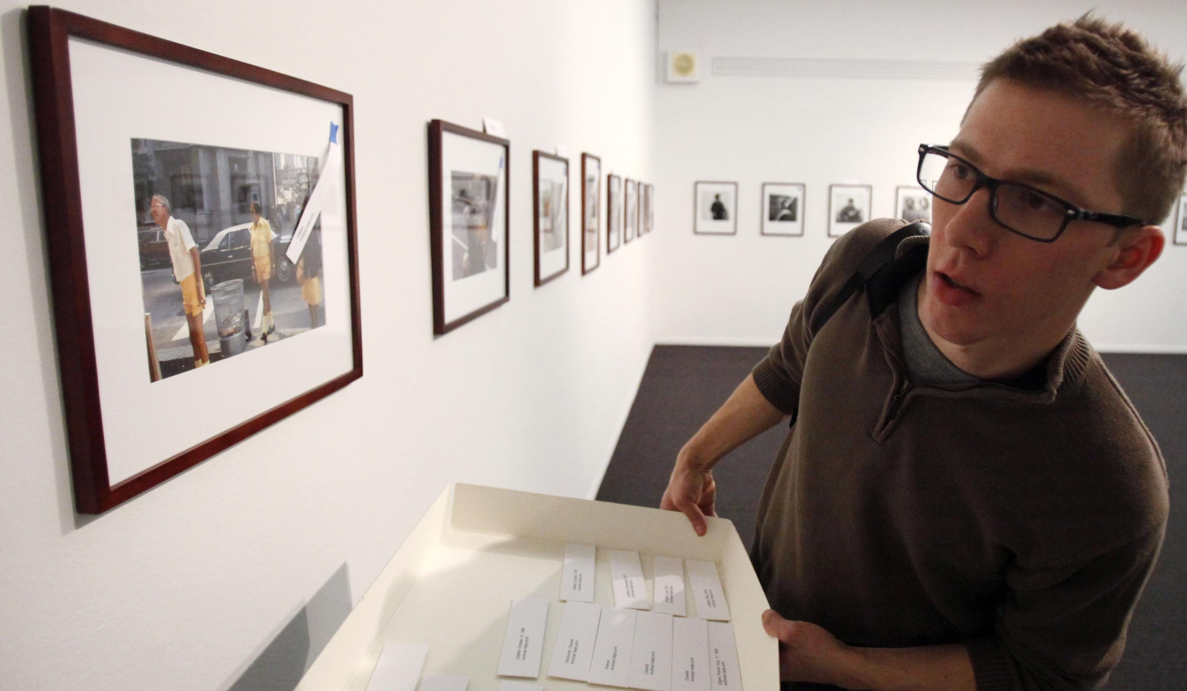 Collector John Maloof matches title tags with photographs by Vivian Maier for an exhibit in Chicago.