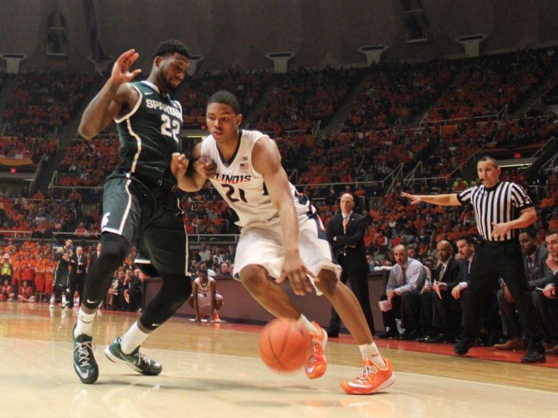 Illini Malcolm Hill drives against Michigan State Spartan Branden Dawson