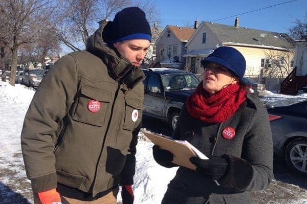 Two people going door-to-door during a political campaign