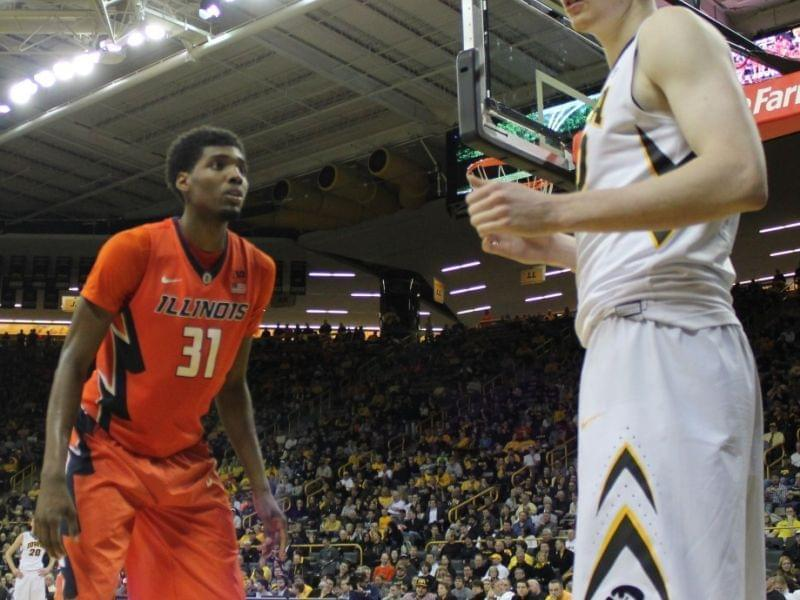 Illini Austin Colbert guards Iowa's Aaron White in Wednesday's loss at Iowa.