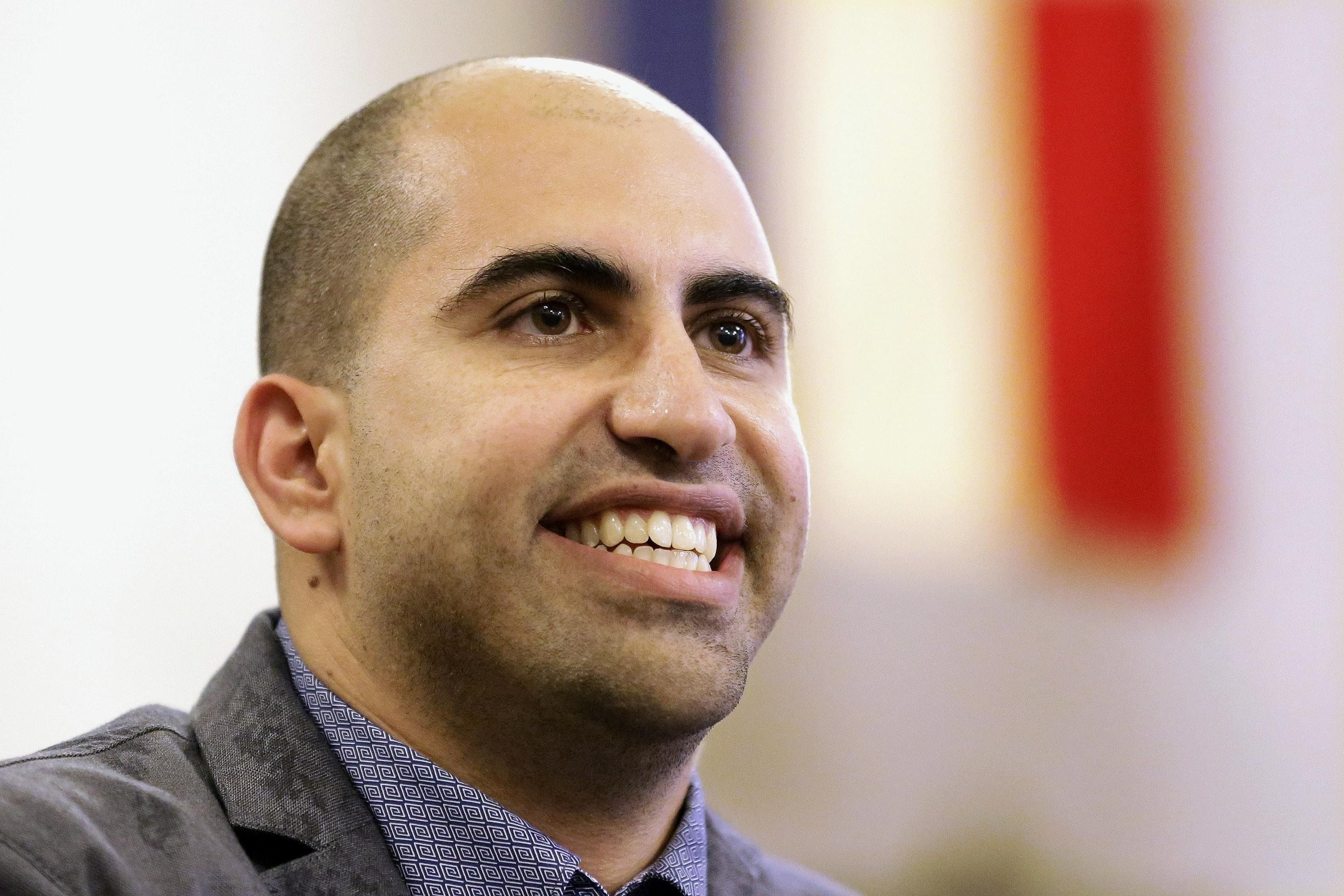 Steven Salaita speaks during a news conference in Champaign in September.