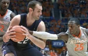 Illini guard Kendrick Nunn tries to take the ball from Northwestern's Alx Olah during Saturday's win.
