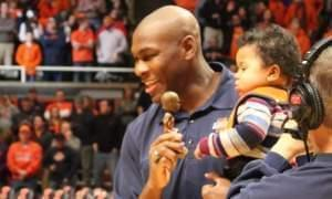 Former Illini basketball player Roger Powell, Jr, with son and Roger Powell Bobblehead