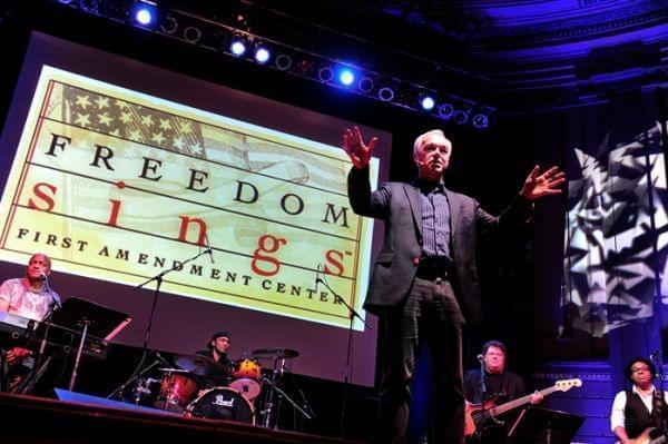 "First Amendment Center president and CEO Ken Paulson narrates a performance of ""Freedom Sings,"" a musical tribute to free speech in America, told through rock, pop, hip-hop and country music."