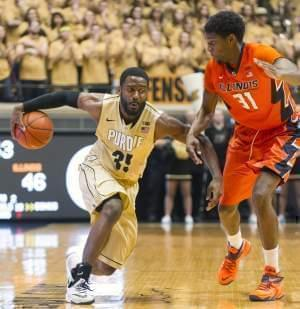 Purdue guard Rapheal Davis makes a move on Illinois forward Austin Colbert during the second half of  Saturday's 63-58 loss at Purdue.