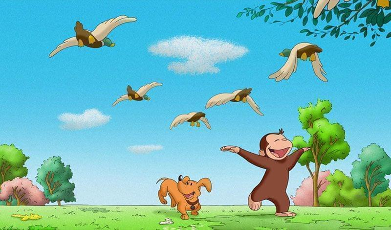 Curious George frolicking outside