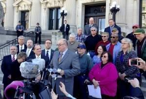 Illlinois AFL-CIO President Michael Carrigan is joined by state workers outside the Illinois Supreme Court.