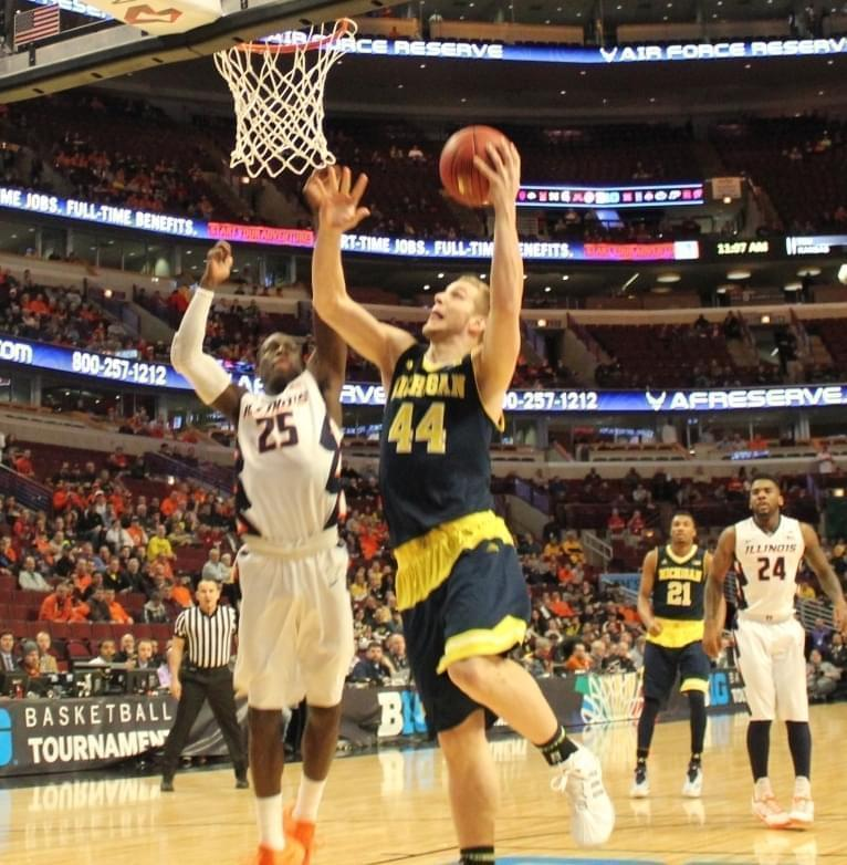 Peoria native Max Bielfeldt lays the ball in for Michigan during the Illini's 73-55 loss.