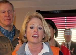 Gov. Bruce Rauner and Comptroller Leslie Munger in Maryville, Ill. in January.