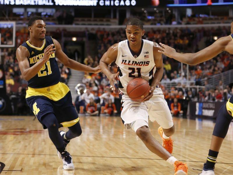 Illini Malcolm Hill drives against Michigan's Zak Irvin in Ilinois 73-55 loss Thursday.