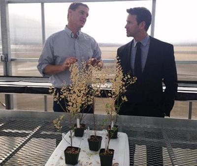 Congressman Aaron Schock visits with WIU agricultural professor Win Phippen.