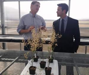 Congressman Aaron Schock visits with WIU agricultural professor Win Phippen.