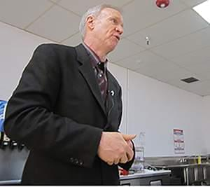 Gov. Bruce Rauner visits with employees of Combe Laboratories in Rantoul on March 11.