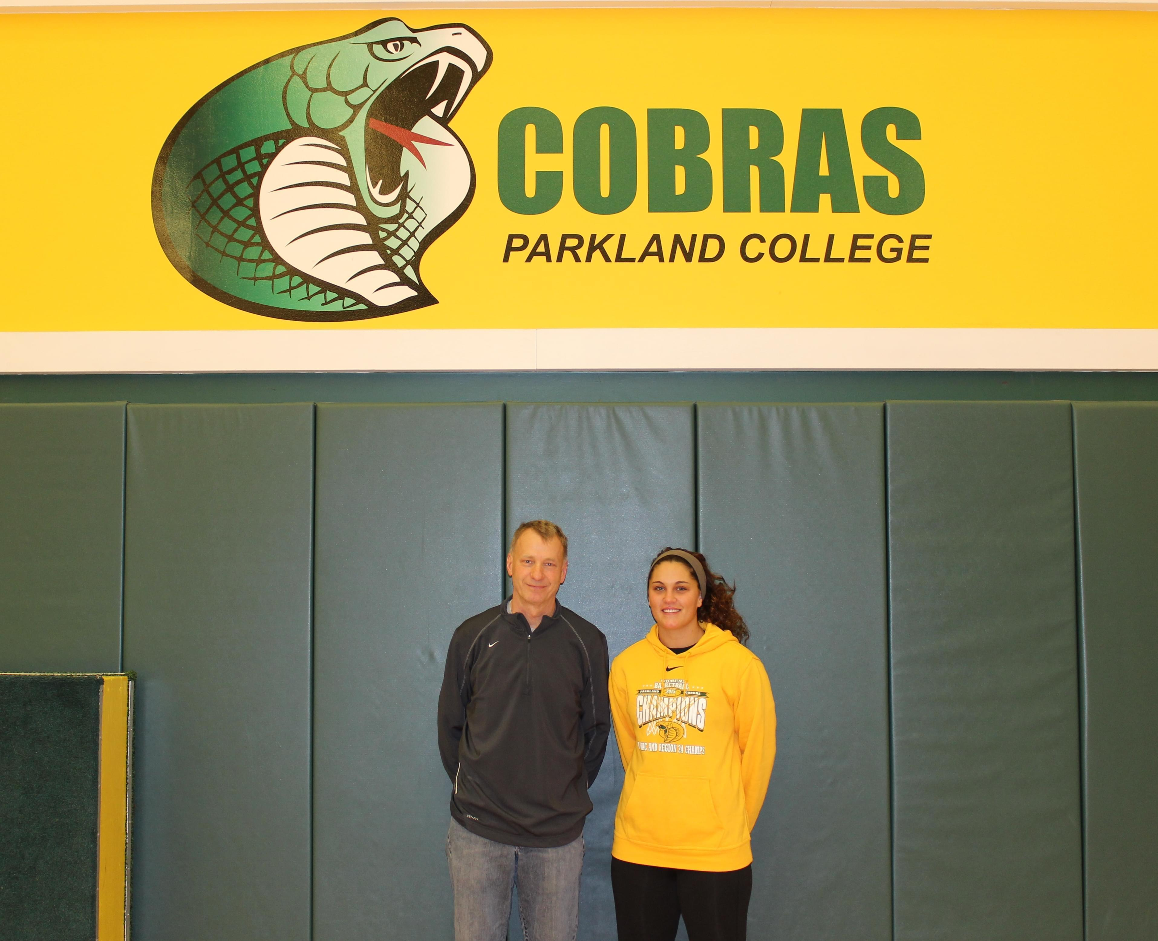 Parkland Lady Cobras head coach Mike Lindemann, with sophomore Nadine Vaughn