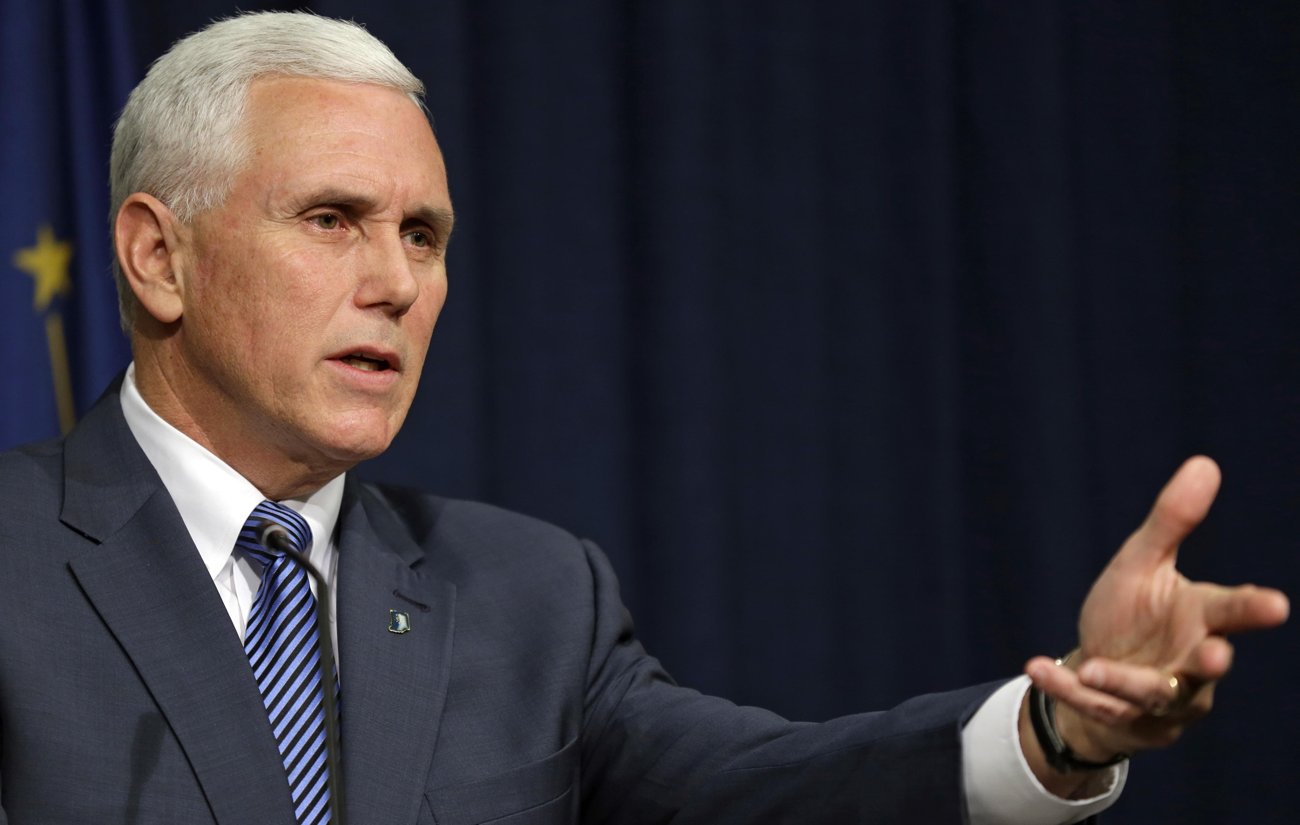Indiana Governor Mike Pence holds a news conference on March 26.