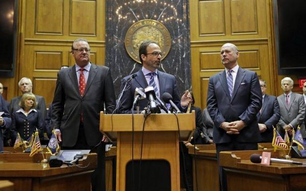 Scott McCorkle, CEO Salesforce.com, joins Indiana Senate President Pro Tem David Long, left, and House Speaker Brian C. Bosma as they announce changes to the state's new religious objections law.