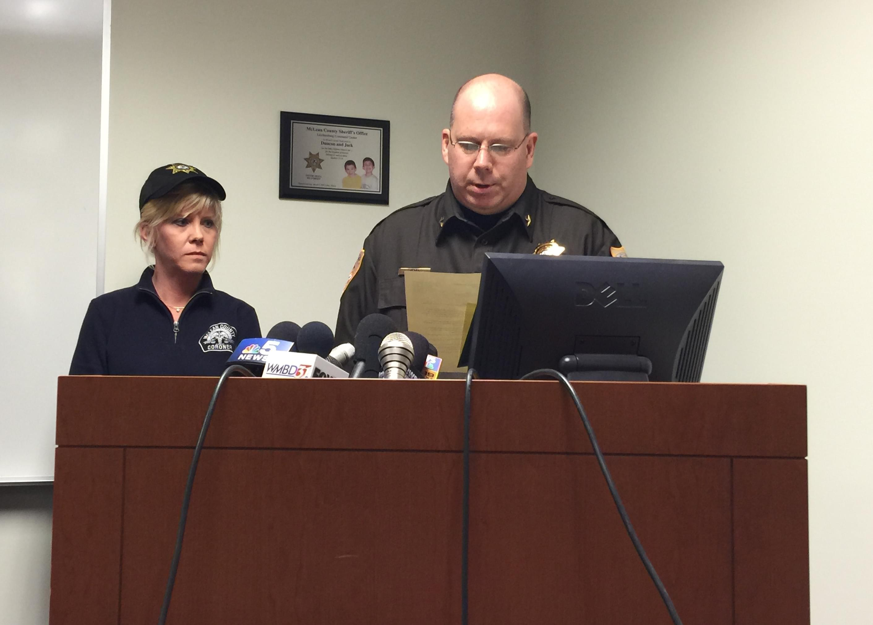 McLean County Sheriff Jon Sandage joined by Coroner Kathleen Davis as he reads a statement to reporters Tuesday.