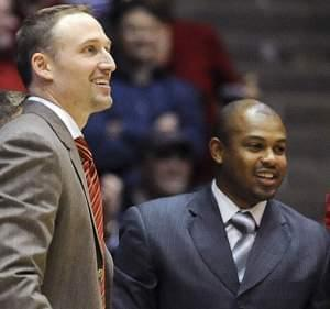 In this Nov. 17, 2013 file photo, Illinois State associate head basketball coach Torrey Ward, right, and head coach Dan Muller smile after a game against Northwestern in Evanston, Ill.