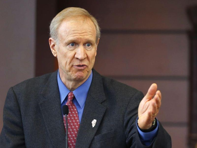 Illinois Gov. Bruce Rauner speaks at a news conference in Chicago. A bipartisan agreement to plug a $1.6 billion budget hole including more than $1.3 billion in fund transfers from a variety of sources to avert shutdowns of Illinois state programs an