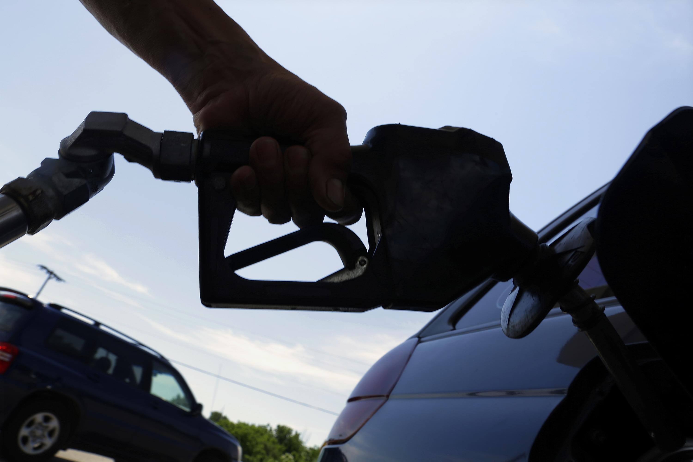 A motorist puts fuel in his car.