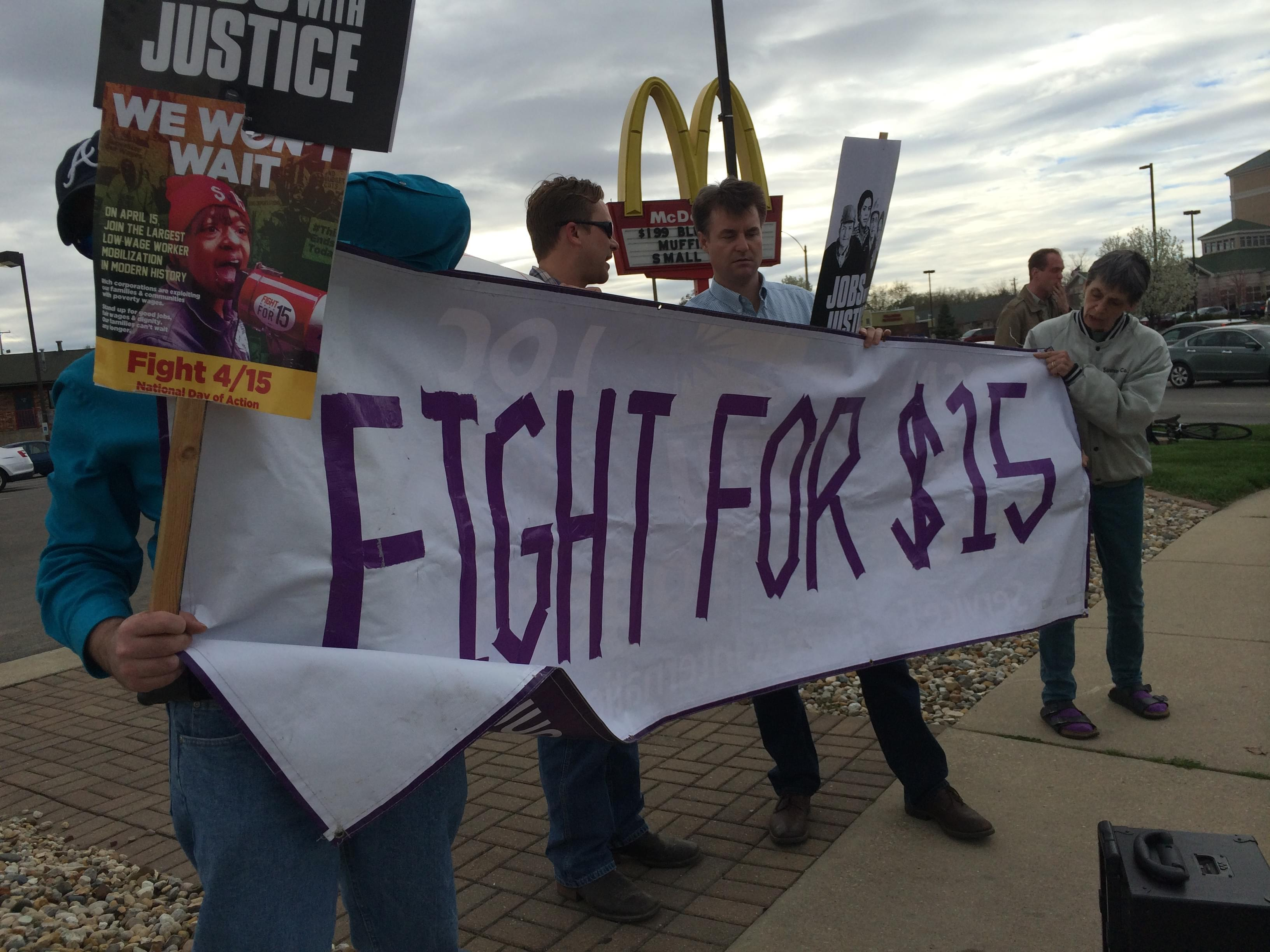 Activists rally for a $15 minimum wage outside of the McDonald's on Neil Street and Kirby Avenue in Champaign Wednesday.