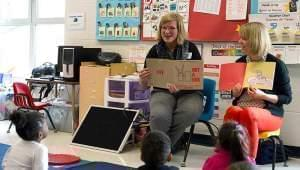 Book mentor reading to students