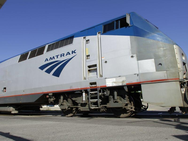 An Amtrak commuter train moves through a crossing gate while traveling to Chicago Tuesday, June 12, 2012 in Springfield.