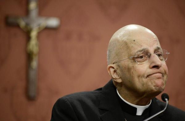 In this Sept. 20, 2014 file photo, Cardinal Francis George speaks at a news conference in Chicago.