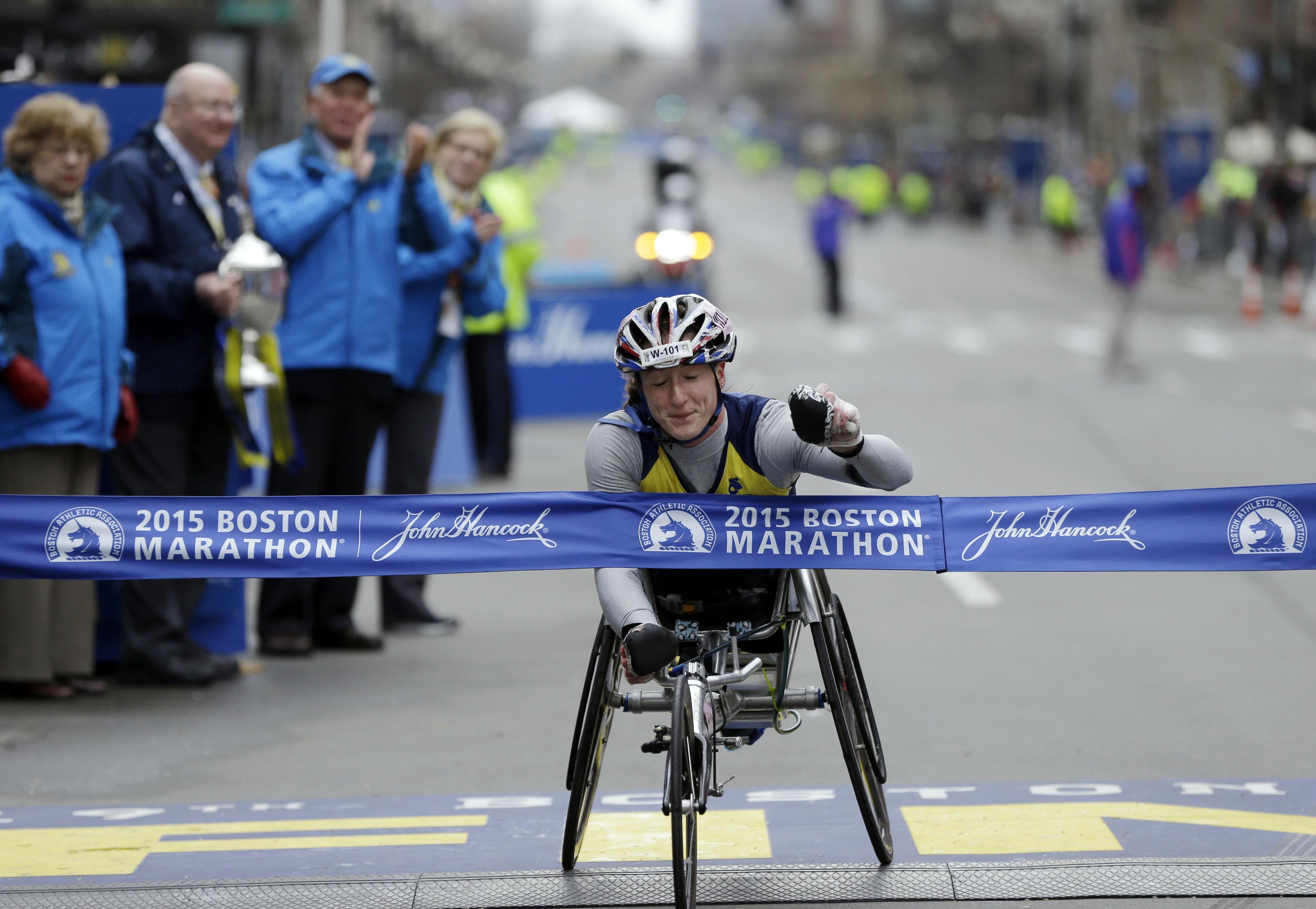 U of I graduate Tatyana McFadden crosses the finish line to win the women's wheelchair division of the Boston Marathon Monday.
