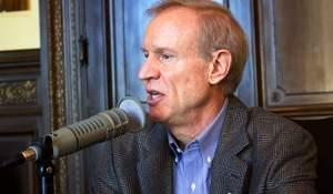 Gov. Bruce Rauner sits for an interview with public radio on Tuesday in his Capitol office.